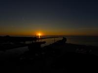 Molo o zachodzie słońca - widok z latarni w Ustce